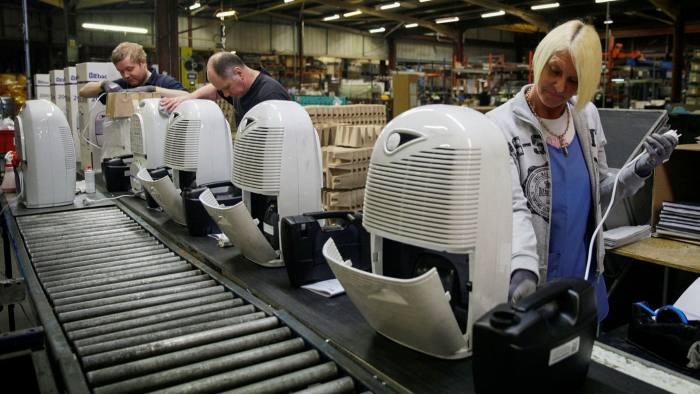 Employees assemble dehumidifiers on the production line at the Ebac Ltd. factory in Newton Aycliffe, U.K